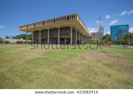 Honolulu, Hawaii, USA, May 19, 2016:  Morning view of the Hawaii State Legislature Building with Downtown Honolulu skyscrapers in the background.