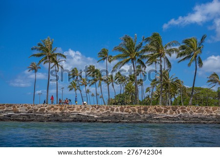 Honolulu, Hawaii, USA, May 11, 2015:  Ocean view of the man made Magic Island in Honolulu.  Recent storms required cleaning which has been completed. - stock photo