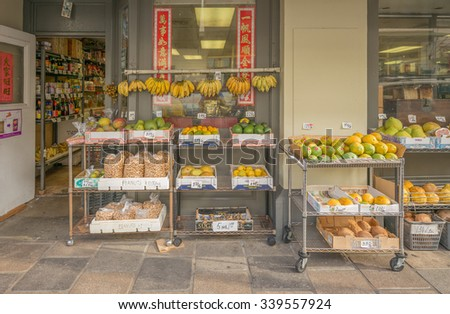 Honolulu, Hawaii, USA, Nov. 15, 2015:  Street view of Honolulu Chinatown as fresh produce is displayed for sale.  Chinatown is on the National Historical Register of Places in America.