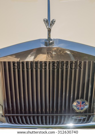 Honolulu, Hawaii, USA, Sept. 3, 2015:  Morning view of a classic Rolls Royce hood and grill.  Rolls Royce is the world's luxury automobile. - stock photo