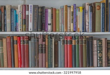Honolulu, Hawaii, USA, Sept. 29, 2015:  Two rows of colorful vintage leather books on a bookshelf.  Old books are becoming rare.