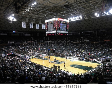 HONOLULU, HI - FEBRUARY 27: Nevada 63 vs. Hawaii 74: Arena view with players waiting an in-bounds pass February 27, 2010 at the Stan Sheriff Center in Honolulu, Hawaii. - stock photo