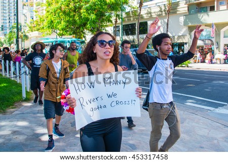 Honolulu, HI. July 9, 2016. Black Lives Matter protesters hit the strip in Waikiki a mere 48 hours after five white police officers are murdered in Dallas,Texas for protecting their right to protest.
