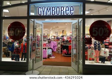 HONOLULU, HI - NOVEMBER 27: Entrance to Gymboree Store featuring 50% off entire store on Grey Thursday evening at Ala Moana shopping center, November 27, 2014 in Honolulu, Hawaii. - stock photo