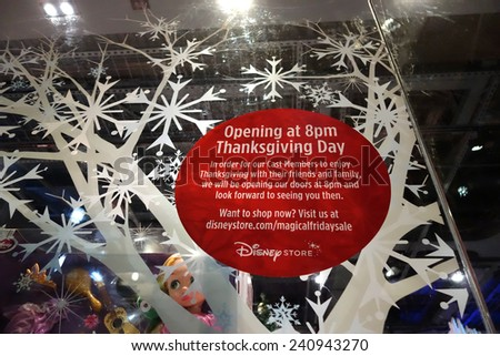 HONOLULU, HI - NOVEMBER 22: 'Opening at 8pm Thanksgiving Day' for Grey Thursday sign at the Disney store in the Ala Moana shopping center on November 22, 2014 at Aloha Stadium in Honolulu, Hawaii. - stock photo