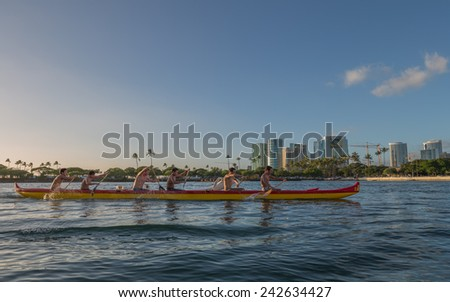 Honolulu, Jan 06:  An outrigger canoe team practices for the State of Hawaii Outrigger Canoe Championships as the sun sets on the stern of their canoe.  Honolulu, Hawaii, USA.  Jan. 06, 2015.