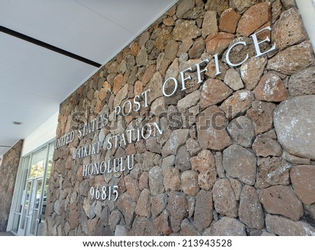 HONOLULU - JULY 25: Metal letters that spell United States Post Office, Waikiki Station, Honolulu, 96815 by entrance, fastened on lava rocks on the side of a building. Waikiki, Hawaii July 25, 2014 - stock photo