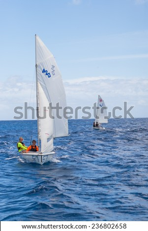Honolulu, July 10:  Tandem sailing offshore for the  Honolulu sailing championship.  Honolulu, Hawaii, USA.  July 10, 2014. - stock photo