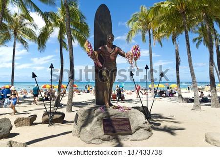 HONOLULU - JUNE 15: Duke Kahanamoku statue holding leis at Waikiki Beach on June 15, 2013. Duke is is remembered as the greatest waterman who ever lived, and Hawaiis ambassador of Aloha. - stock photo