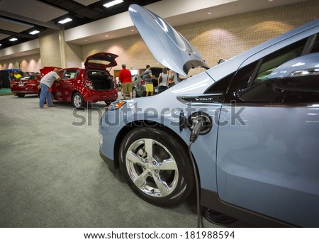 HONOLULU -MARCH 15, 2014: The Chevrolet Volt on display at the 2014 First Hawaiian International Auto Show. The Volt is currently the most efficient car with a gas engine sold in the United States - stock photo
