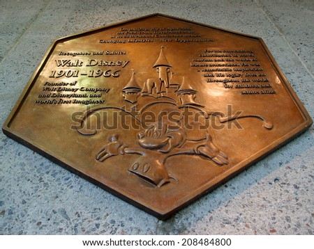 HONOLULU, MAY 27: Recognize and salute of the worlds first imagineer Walt Disney's plaque featuring Mickey Mouse and Disneyland at Honolulu Internation Airport, Honolulu, Hawaii on 27 May 2014. - stock photo