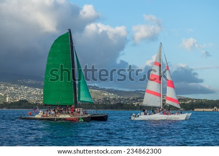 Honolulu, May 17:  Two catamarans with tourists off Waikiki to watch the Hawaii Sailboat Race:  Honolulu, Hawaii, USA.  May 17, 2014. - stock photo