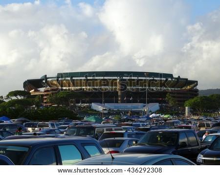 HONOLULU - SEPTEMBER 19: Cars fill parking lot leading to Aloha Stadium before start of College football game on September 19, 2015. - stock photo
