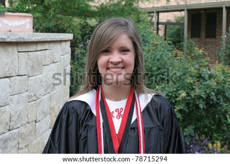 honor graduate in robe with chords - stock photo