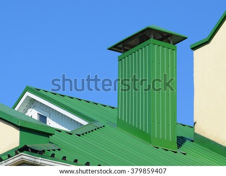Hood On The Roof Of The Metal Sheets. Roofing Materials.