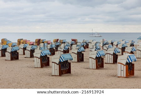 Hooded beach chairs (strandkorb) at the Baltic seacoast in Travemunde city, Germany - stock photo