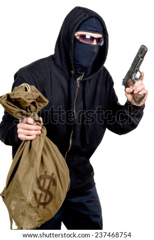 hooded robber with a gun and a bag of money - stock photo