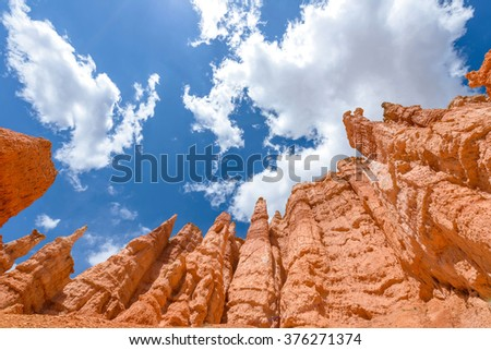 Hoodoos in the Sky - Colorful hoodoos, against bright blue sky and white clouds, at Queens Garden of Bryce Canyon National Park, Utah, USA. - stock photo