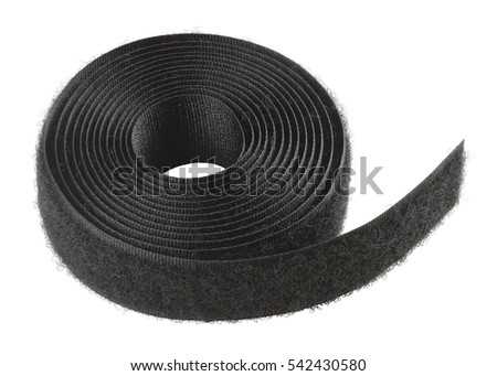 "Hook and loop part fastening system. The fabric strip roll with ""hairier"" loops. Object is isolated on white background without shadows"