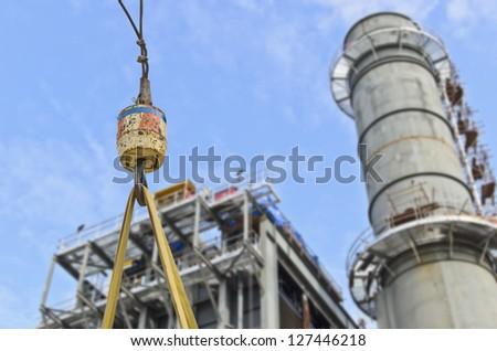 hook crane on gas power plant background - stock photo