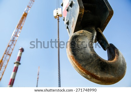 Hook of a mobile lifting crane on a construction site, capable of lifting 25 tons of load. Heavy duty machinery for heavy construction industry.  - stock photo