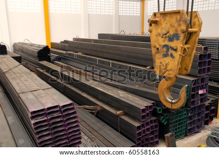 Hook on the crane in steel warehouse - stock photo