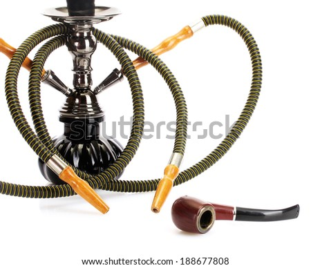 hookah and pipe on white background close-up - stock photo