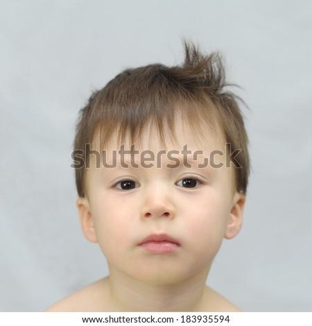 Hooligan boy with a tuft - stock photo