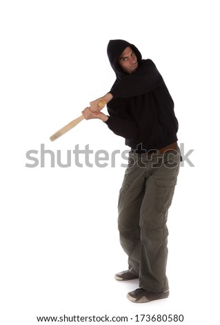 Hooligan swinging a baseball bat isolated on white - stock photo