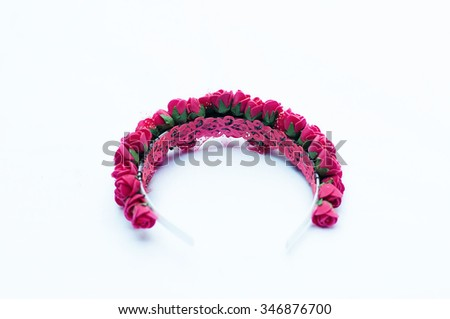 Hoop from flowers, wreath with colored flowers. Handmade flowers wreath on white. Accessory. Artificial flowers. Hair accessories. Beauty. Fashion. Decoration for the head. Wreath hair - stock photo