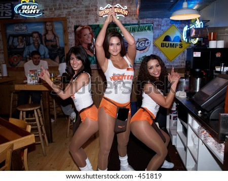 Hooters girls posing as Charlie's Angels