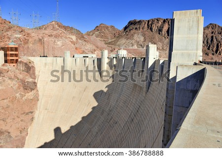 Hoover Dam, a massive hydroelectric engineering landmark located on the Nevada and Arizona border built to harness power from the Colorado River, is a top tourist attraction from Las Vegas, Nevada - stock photo