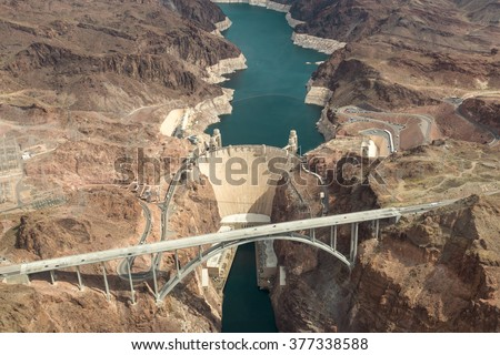 Hoover Dam Aerial View Aerial view of the Colorado River Bridge and the Hoover Dam in Nevada, Arizona, USA. There is a hydroelectric power station, a bridge and a dam wall. - stock photo