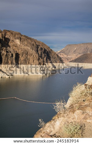 Hoover dam and Lake Mead in Las Vegas area. Hoover Dam is a major tourist attraction on Nevada / Arizona border - stock photo