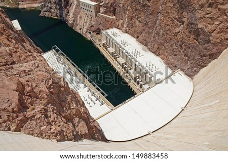 Hoover Dam hydroelectric power plant. Concrete arch-gravity dam in the Black Canyon of the Colorado River, on the border between the US states of Arizona and Nevada - stock photo