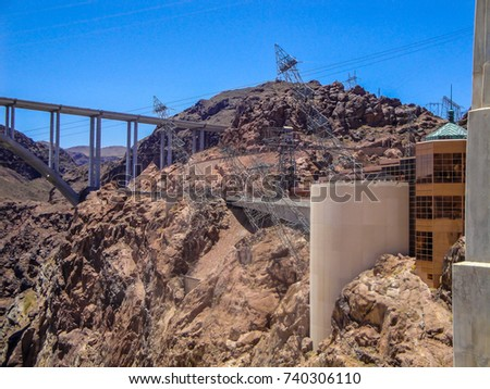 Hoover Dam in United States of America. Hydroelectric power station on the border of Arizona and Nevada. Hoover Dam is very famous tourist attraction for travelers. Hoover dam background.