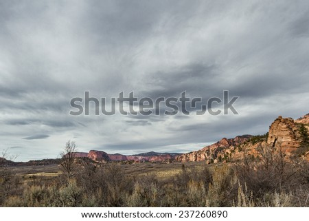 hop valley trail in Zion national park with darks stormy clouds - stock photo