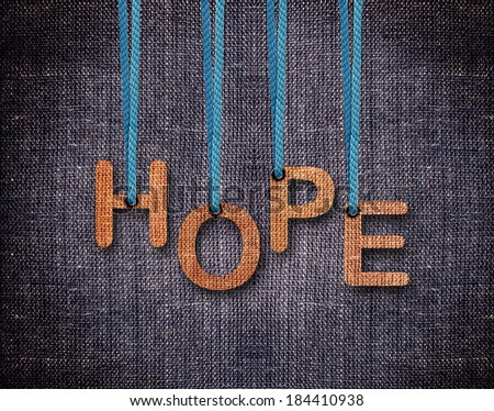 Hope Letters hanging strings with blue sackcloth background. - stock photo