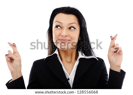 Hopeful businesswoman holding her fingers crossed and looking at the side of the image. Isolated on white background - stock photo