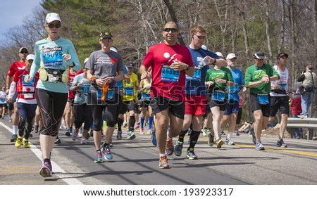 HOPKINTON, USA - APRIL 21: Amateur athletes heading to the finishing line in Boston, MA, USA a few minutes after the start of the Boston Marathon 2014 in Hopkinton on April 21, 2014.