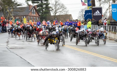 HOPKINTON, USA - APRIL 20: Athletes with disabilities competing in the Boston Marathon 2015 a few seconds after the start of the race in Hopkinton, MA, USA on April 20, 2015.