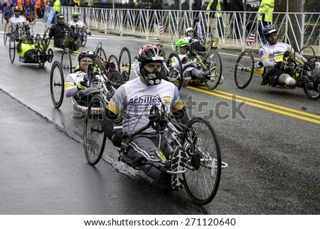 Hopkinton, USA - April 20: Athletes with disabilities competing in the Boston Marathon 2015 in Hopkinton, Massachusetts, USA a few seconds after the start of the race on April 20, 2015. - stock photo