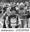 HOPKINTON, USA - APRIL 15: Elderly athletes taking part of the Boston Marathon 2013 in Hopkinton, Massachusetts, USA heading fast and steady to Boston downtown on April 15, 2013. - stock photo