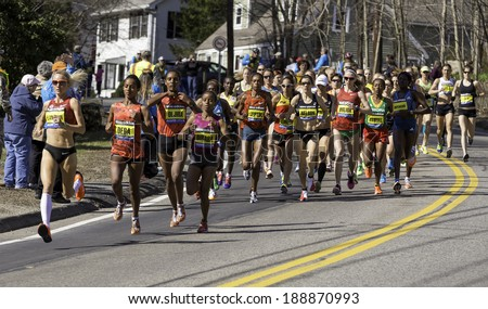 HOPKINTON, USA - APRIL 21: Elite female athletes heading fast andnsteadily from Hopkinton to Boston in Massachusetts, USA a few minutes after the start of the Boston Marathon 2014 on April 21, 2014.