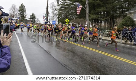 HOPKINTON, USA - APRIL 20: Elite Female athletes running fast and steadily from Hopkinton to Boston in MA, USA a few seconds after the start of the Boston Marathon 2015 on April 20, 2015.