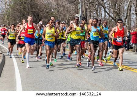 HOPKINTON, USA - APRIL 15: Elite Men Wave One right after the start of the Boston Marathon 2013 in the city of Hopkinton heading to the finishing line in Boston, Massachusetts, USA on April 15, 2013. - stock photo
