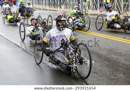 HOPKINTON, USA - APRIL 20: The Boston Marathon 2015 with the participation of athletes with disabilities a few minutes after the start of the competition in Hopkinton, MA, USA on April 20, 2015. - stock photo
