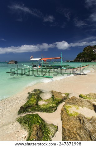 Hopping boat on the sea by Boracay beach in Philippines - stock photo