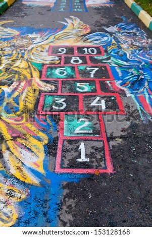 Hopscotch court drawn by chalk on urban pavement - stock photo