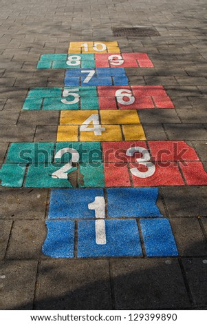 Hopscotch game on schoolyard - stock photo